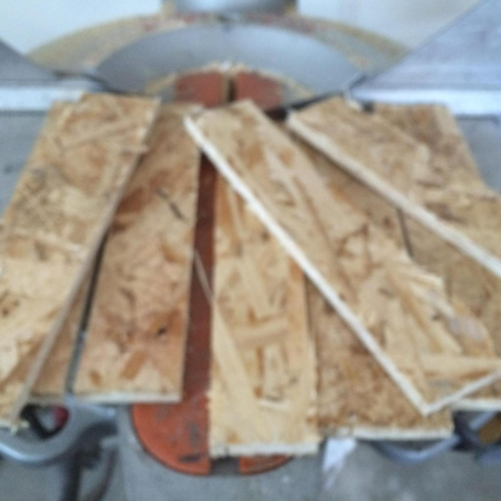 Cut strips of wood for drywall backing