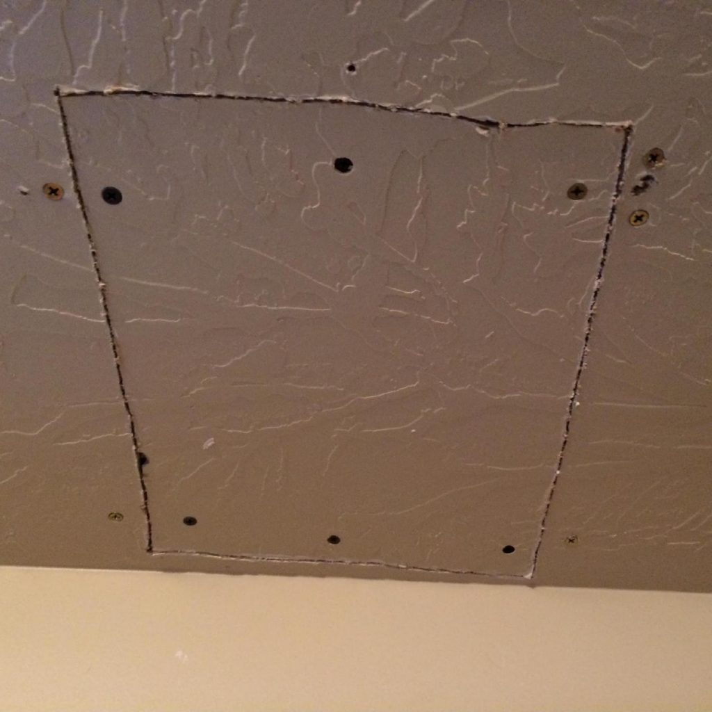 Screw your cut out drywall back in.
