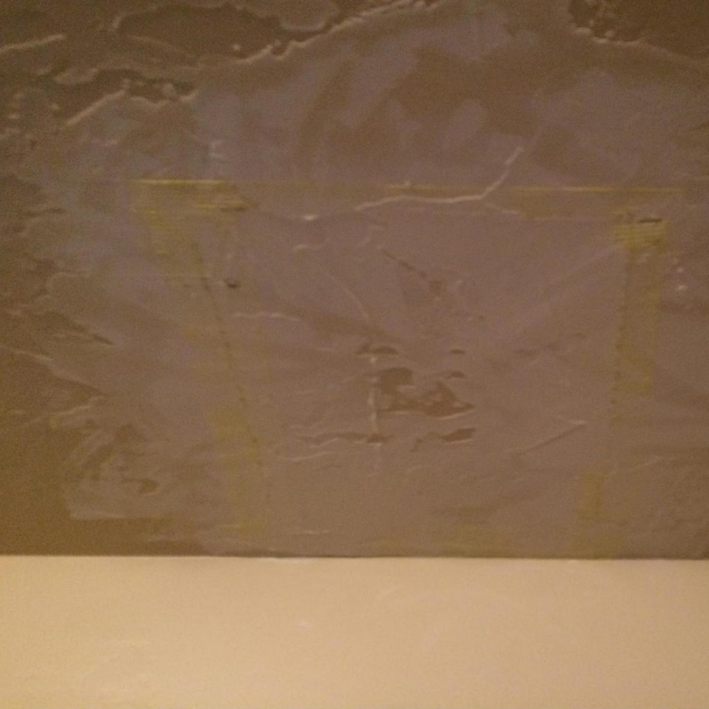 Apply joint compound over the drywall tape
