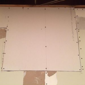 Screw drywall patch into the wall